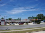 Building Exterior Inline Coin Lundry Fresh Meat IGA with Sunoco freestanding